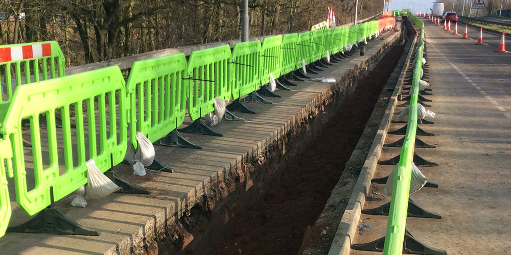safety barriers protecting a trench